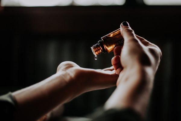 Woman using massage oil.