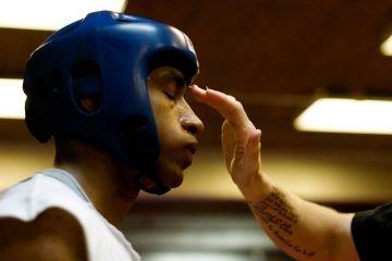 amateur boxer receiving treatment