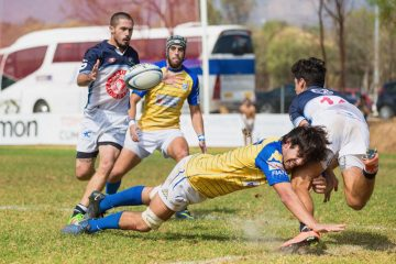 rugby player making a tackle