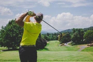 golfer striking ball